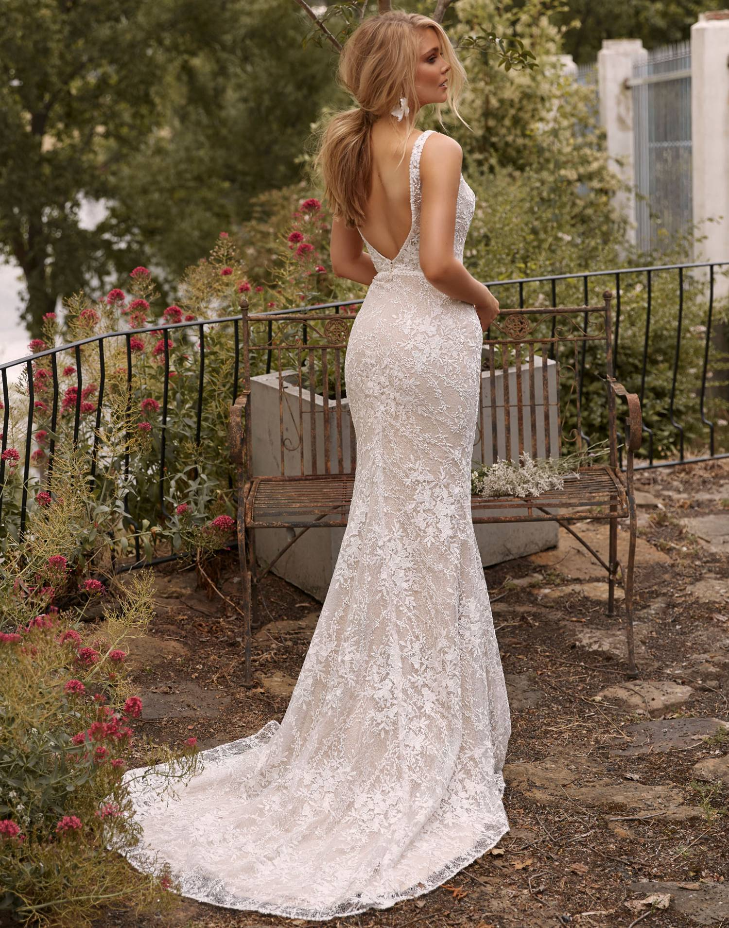 Cayla-wedding-dress-madi-lane-bridal-back-view-with-overskir-min